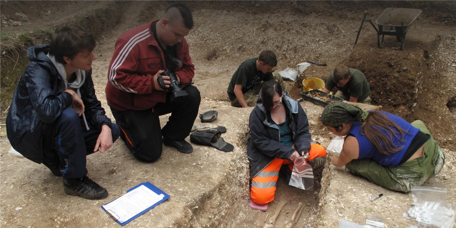 Video being taken of volunteers excavating an inhumation on project florence