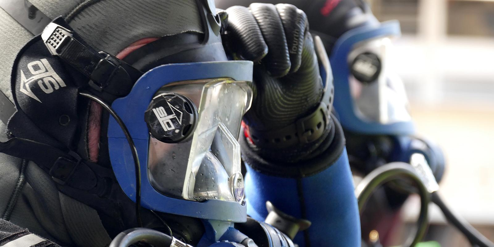 Side profile of a diver's head wearing a face mask, before diving.
