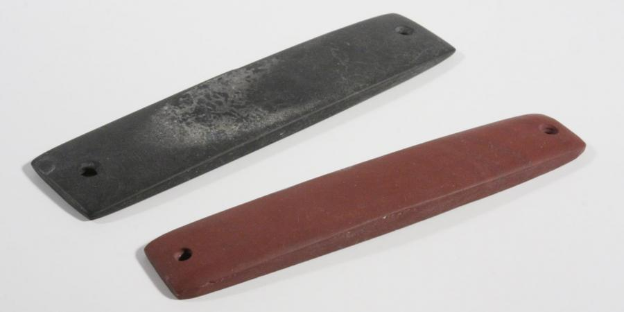 Two archer stone wristguards