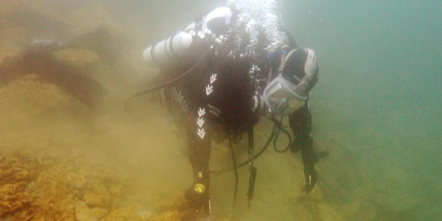 Diver investigating a heritage asset as part of the Scottish Underwater Diving Services
