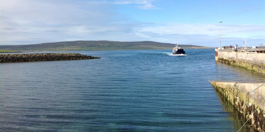 Rousay and a calm sea