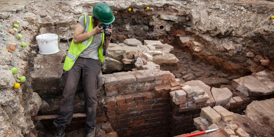 Archaeologist recording industrial archaeology at Sheffield Castle