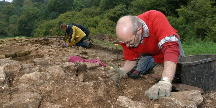 Volunteer helping to excavate a Roman building at Truckle Hill