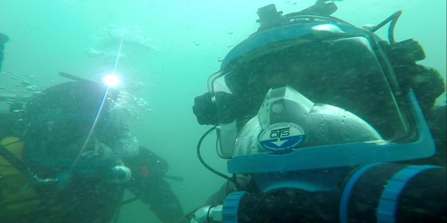 Wessex Archaeology divers examining a wreck site