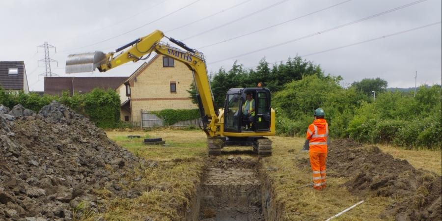 Digger excavating a trench