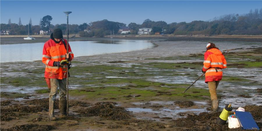 Intertidal fieldwork, undertaking an auger survey on the coast