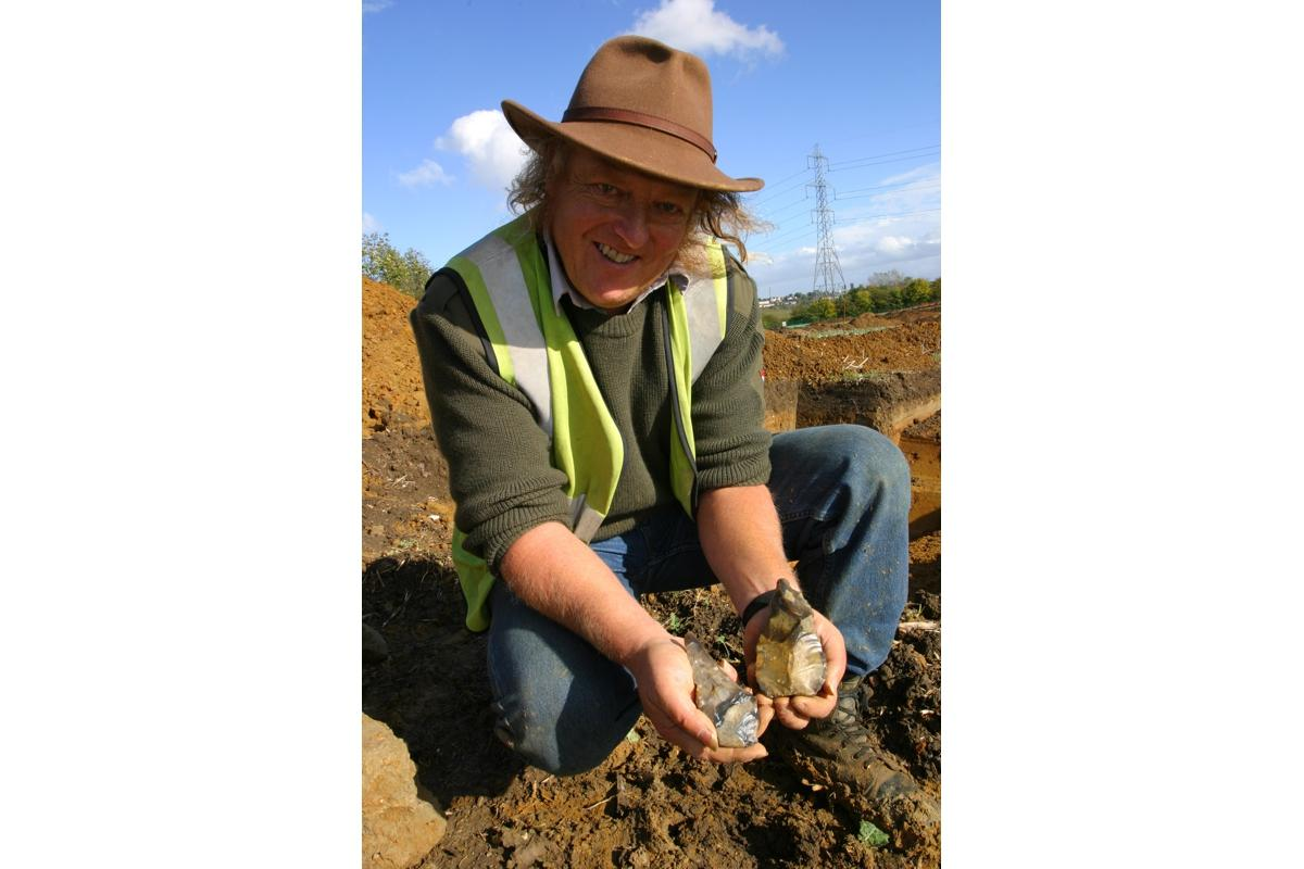 Phil Harding with handaxes