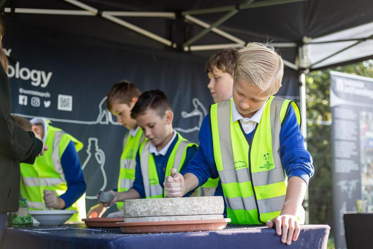 School children learning about archaeology on site at Somerton