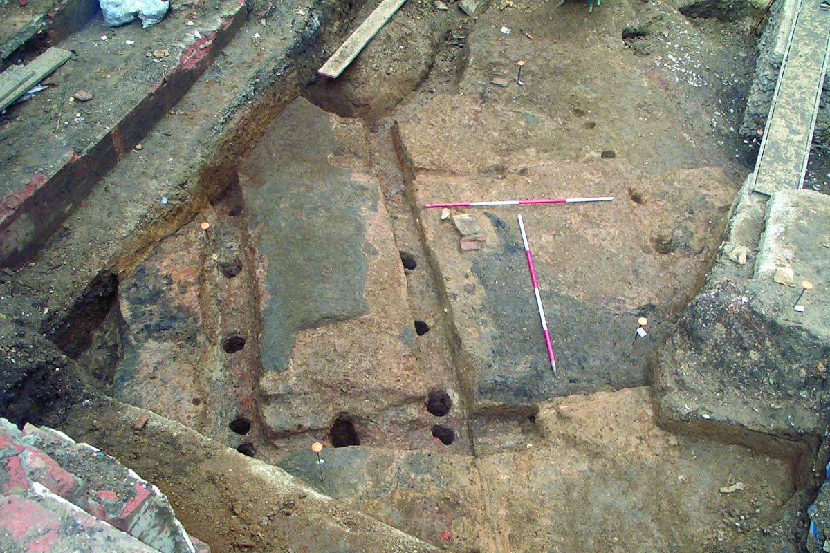 Fenchurch early Roman building remains showing clay floors and posthole remains