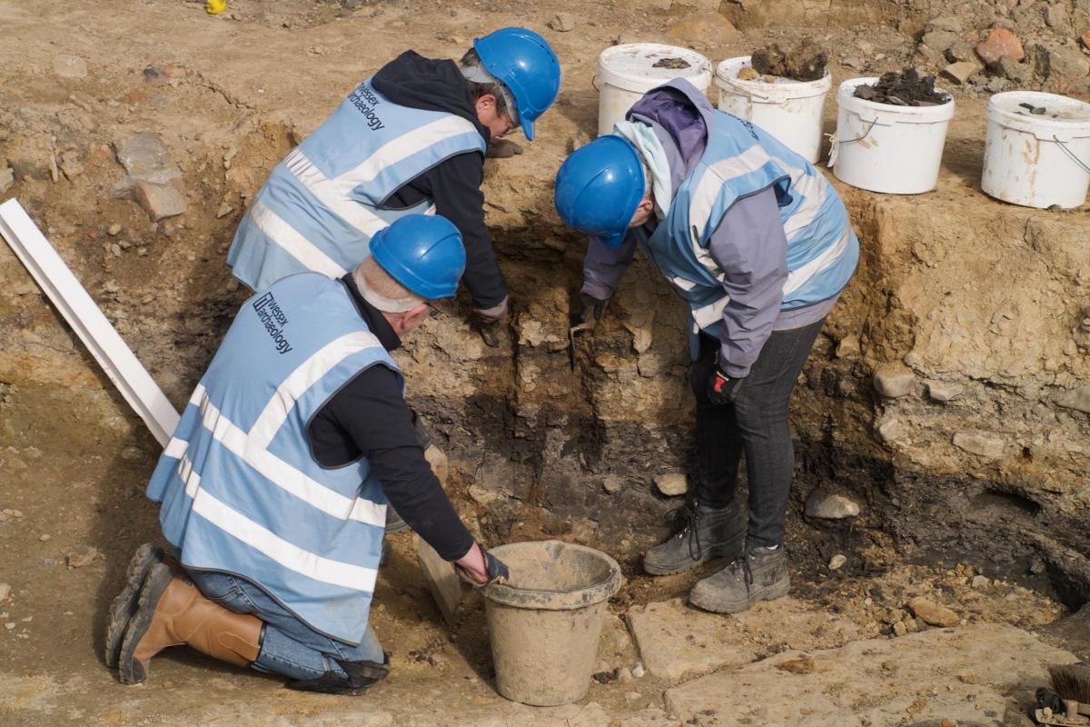 Volunteers looking at a section through a trench at Sheffield Castle excavations