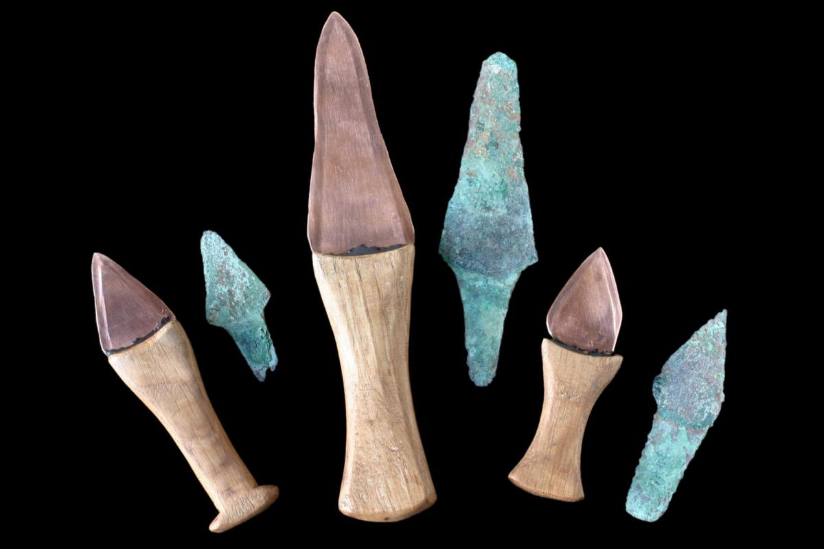 three bronze knives recovered from the Amesbury Archer grave and relicas