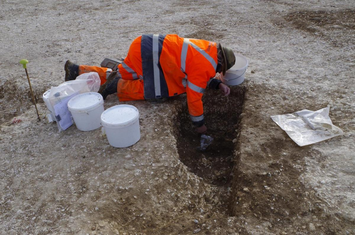 Excavating a Neolithic pit at Bulford