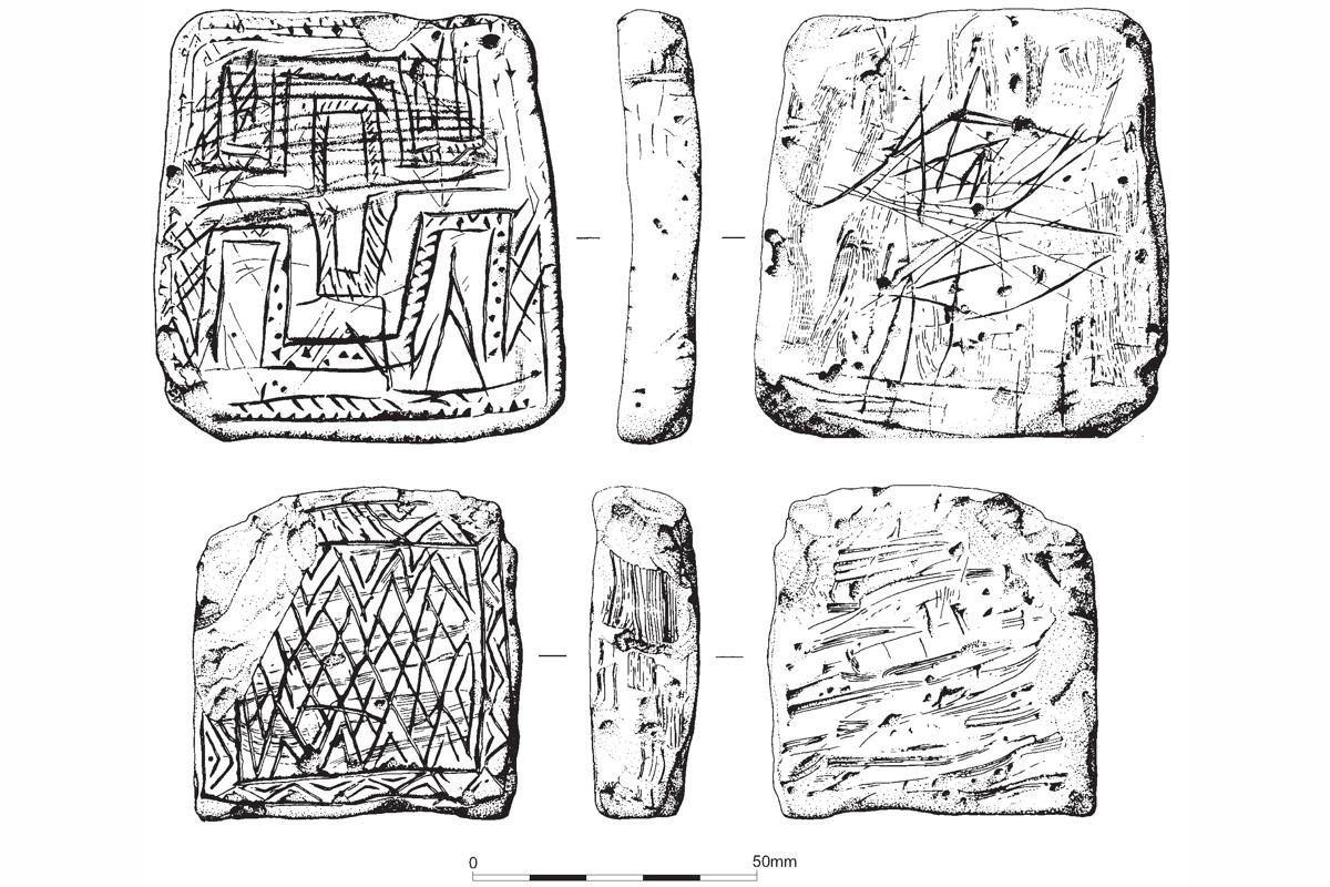 Decorated chalk plaque found in a Late Neolithic pit on King Barrow Ridge