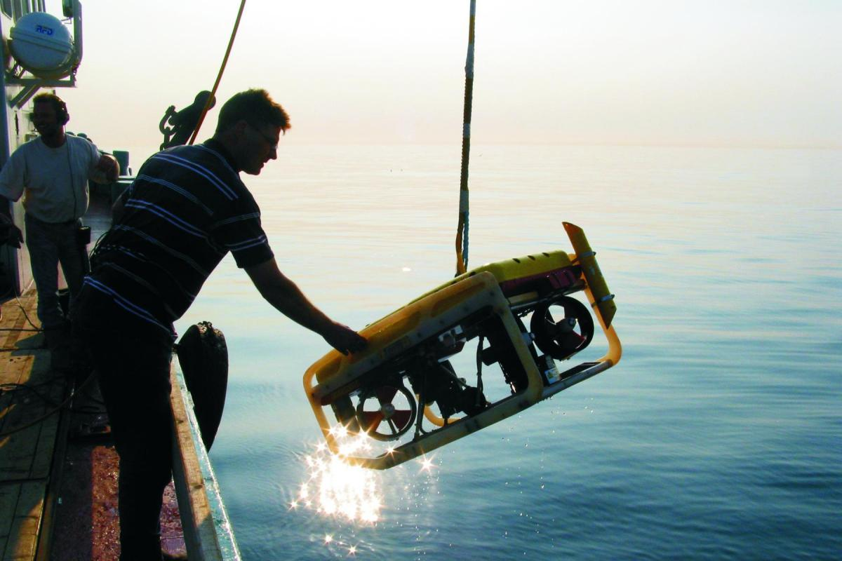 Retained Archaeologist: launching a remote sensor vehicle (ROV)