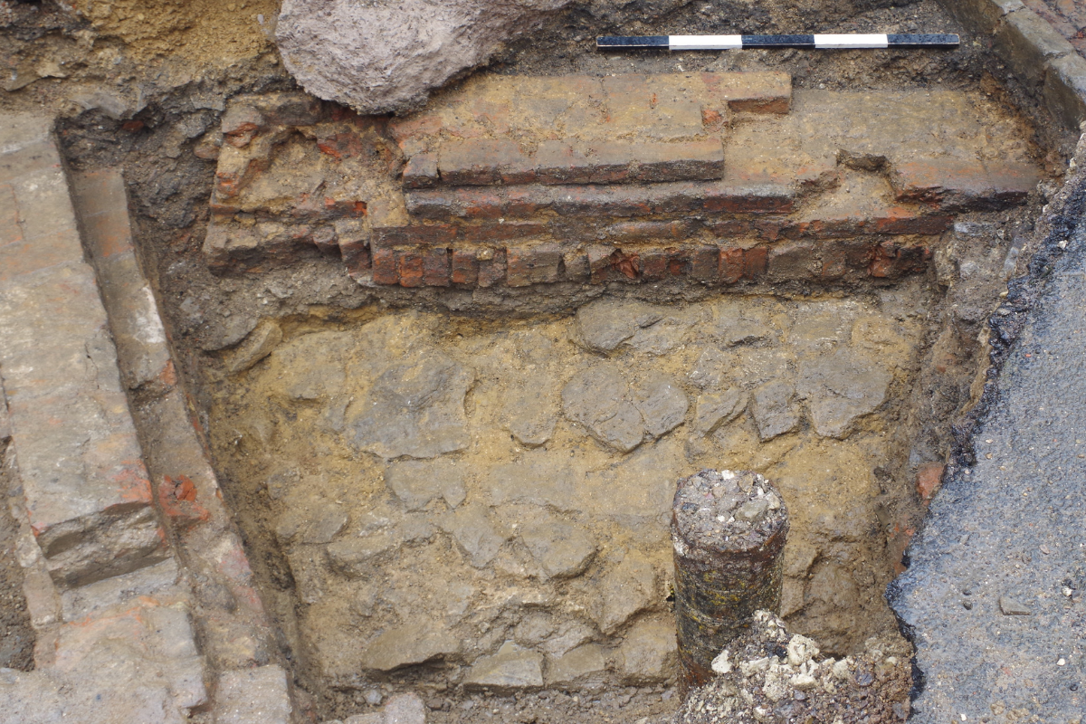 Medieval wall to the north of the keep and foundations of a possible c.1650 bridewell, cut by the wall of a late 18th-century exercise yard