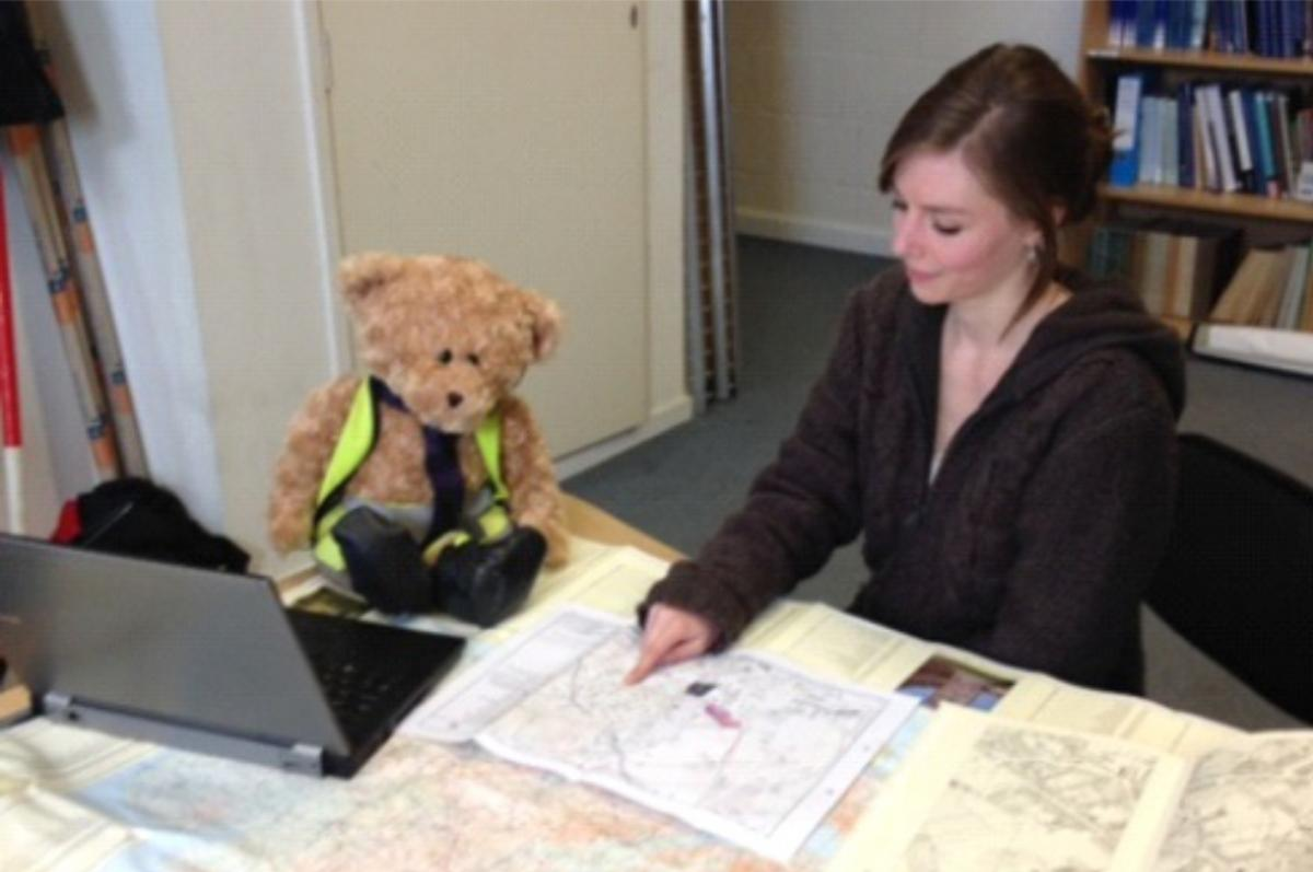 Kent Jones bear archaeologist helping a heritage consultant with mapping