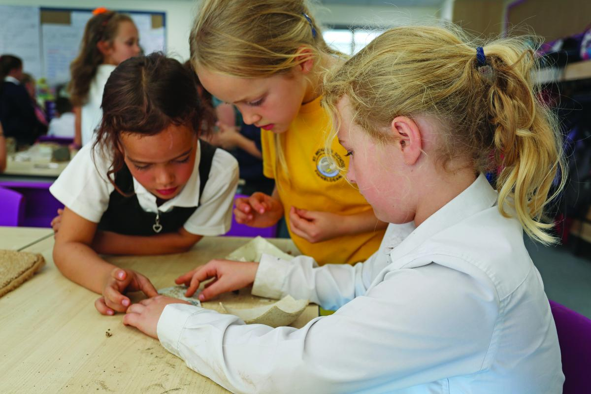 School children learning about archaeology and heritage