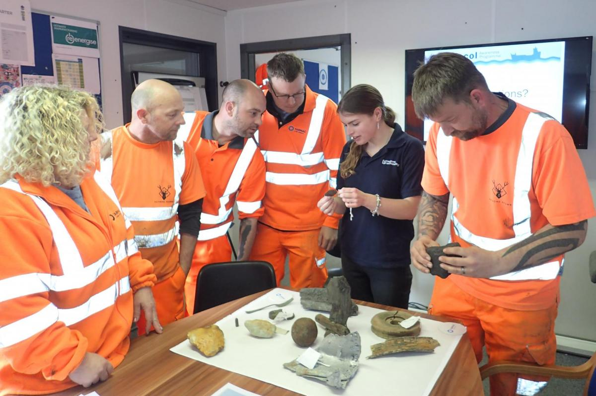 Marine Aggregate Industry crew examine archaeological finds reported through the Protocol