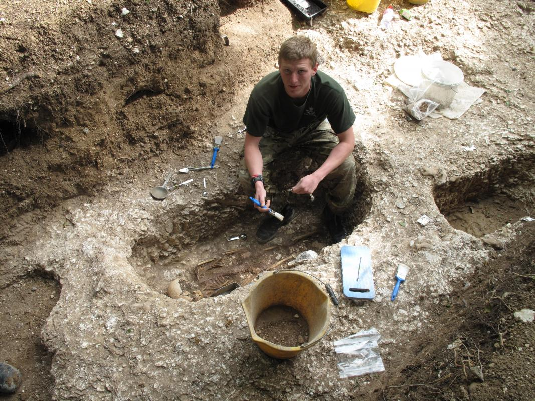 Service personnel excavating a Saxon burial