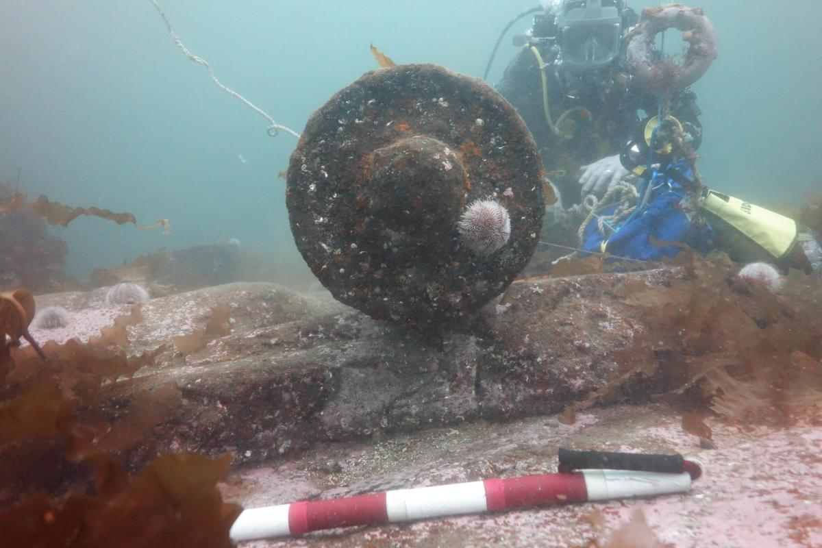Wessex Archaeology diver documenting a cannon on the Queen of Sweden wreck site