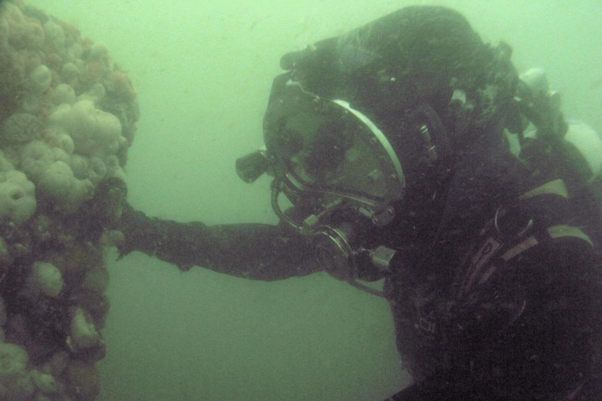 A diver on the wreck of the Resurgam
