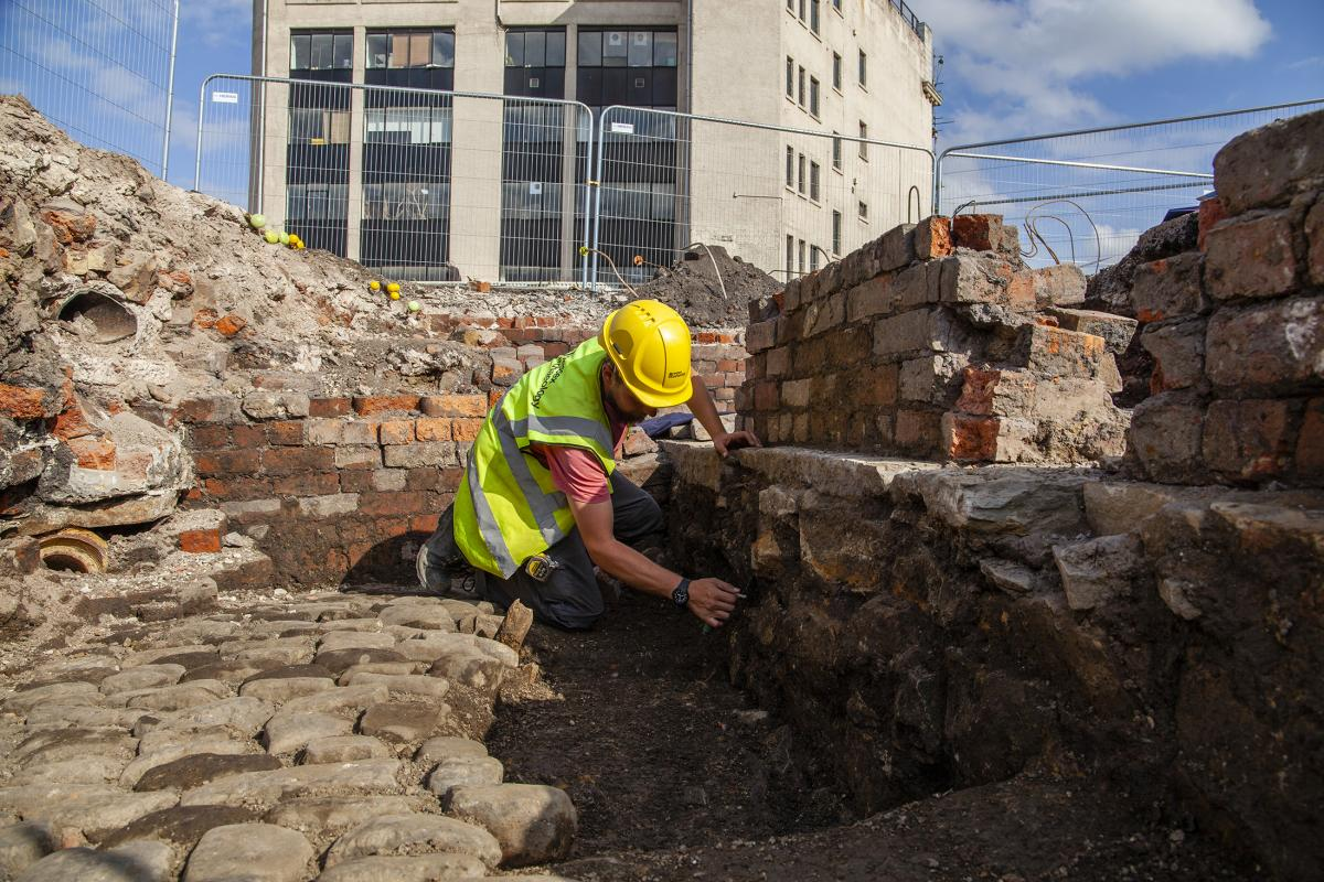 Archaeologist excavating industrial archaeology at Sheffield Castle