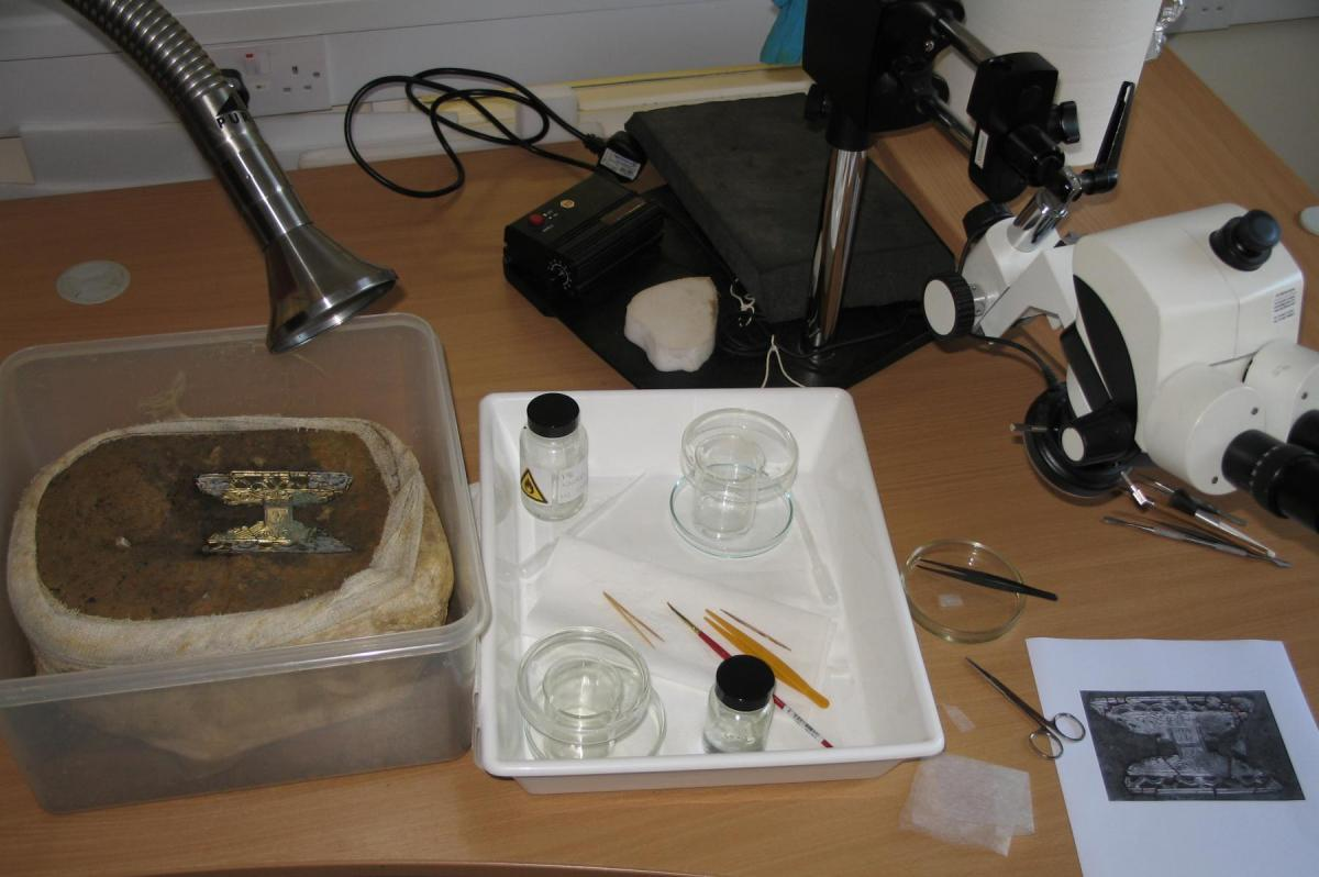 Conservation work on the brooch from West Langton