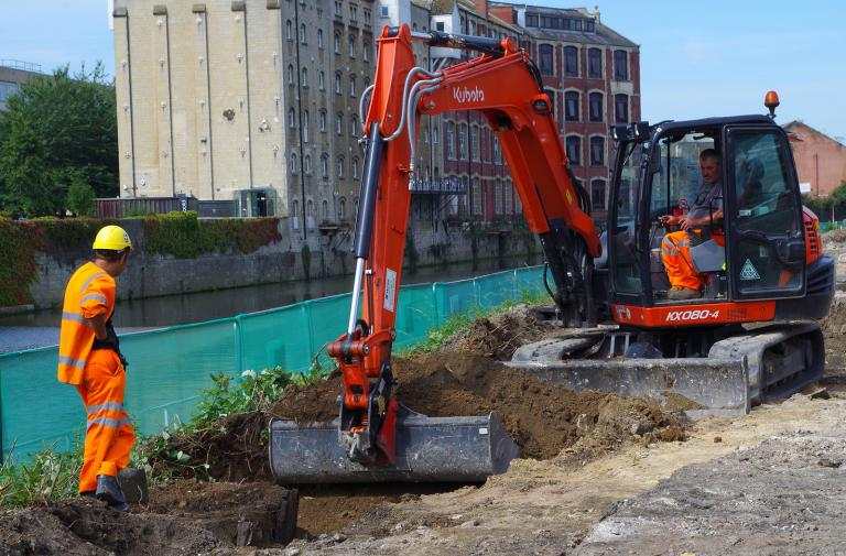 Watching machine digging at Bath Quays