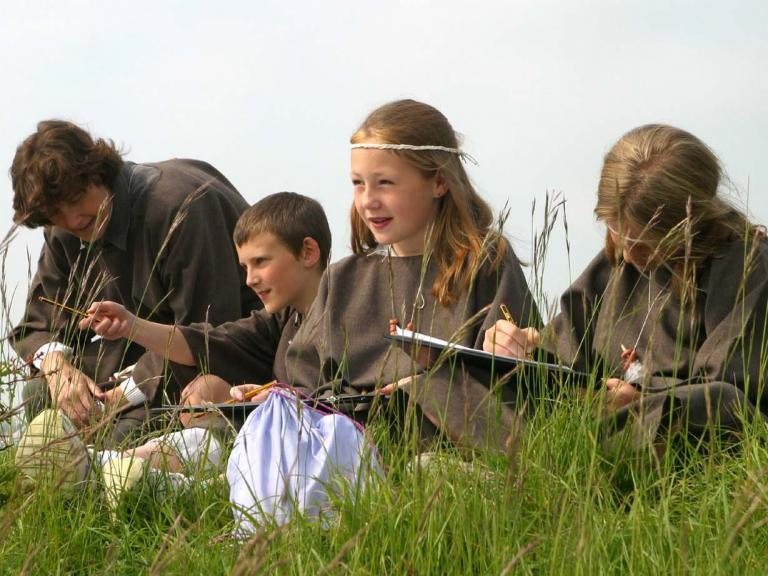 Children learning about archaeology outside of the classroom