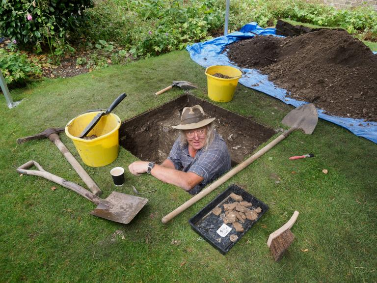 Phil Harding excavating a test pit at Salisbury Museum