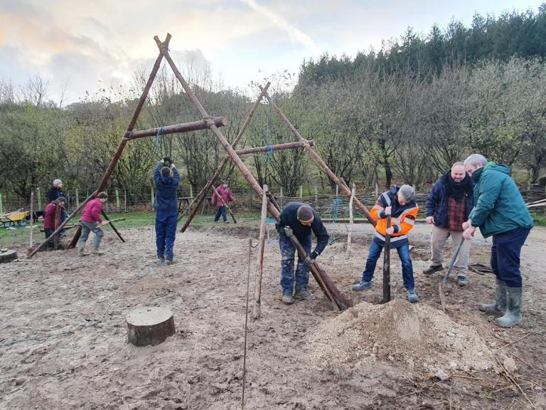 Raising the A frame at Butser Ancient Farm's Neolithic house build