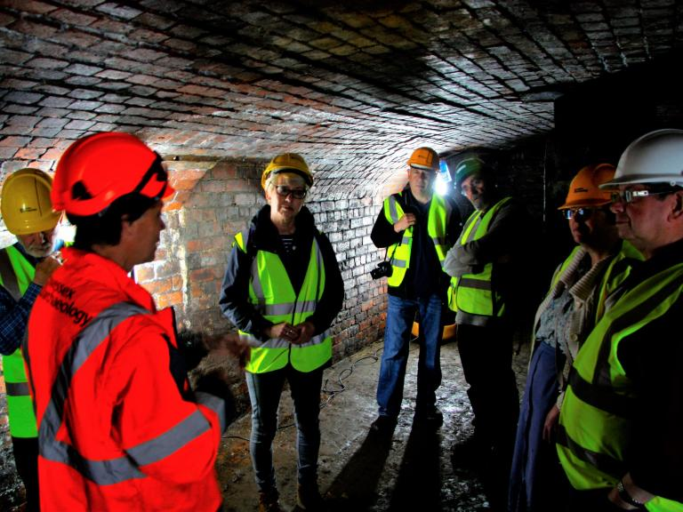 Staff and visitors wearing PPE during a tour of former steel works