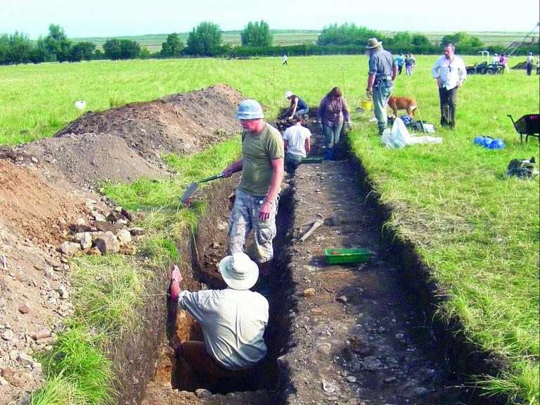 Excavating an evaluation trench at Brancaster