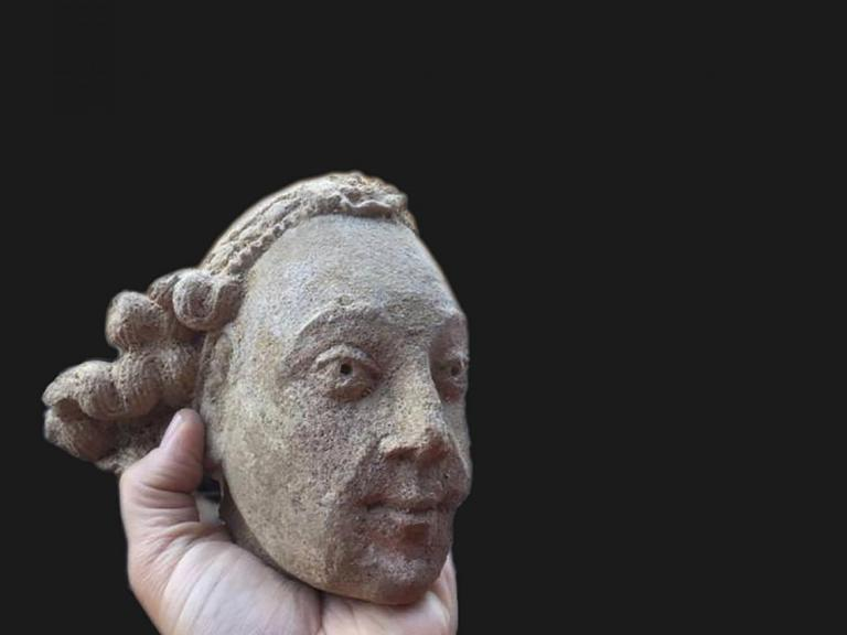 Medieval carved stone head from Bath Abbey