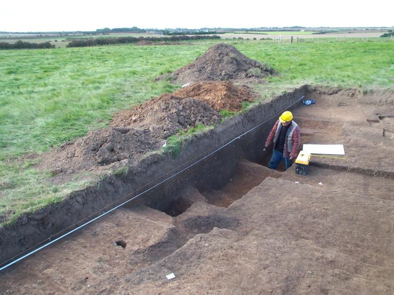 Excavating and recording a trench at Skipsea