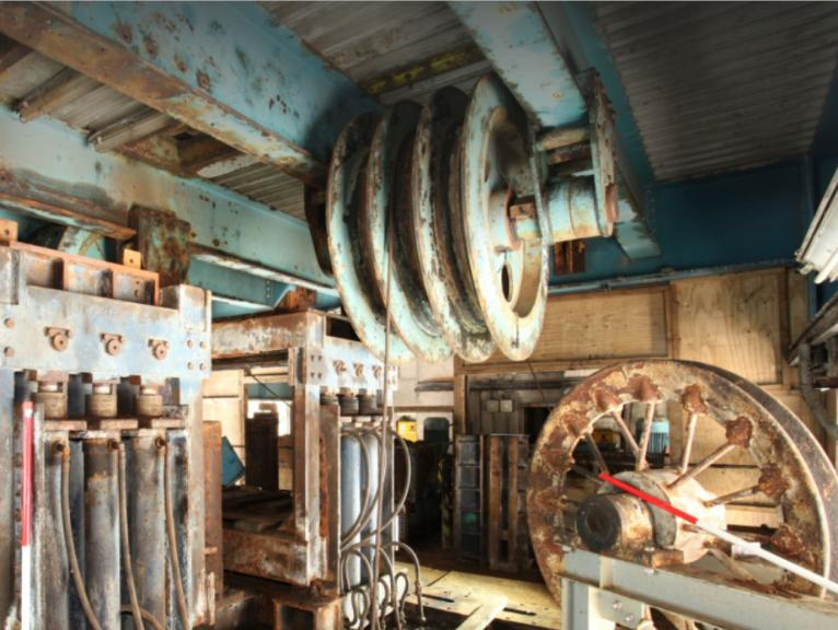 Historic colliery building with cogs and machinery
