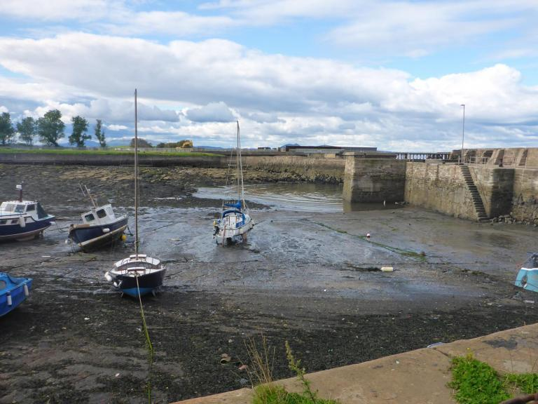 Boats in a harbour at low tide