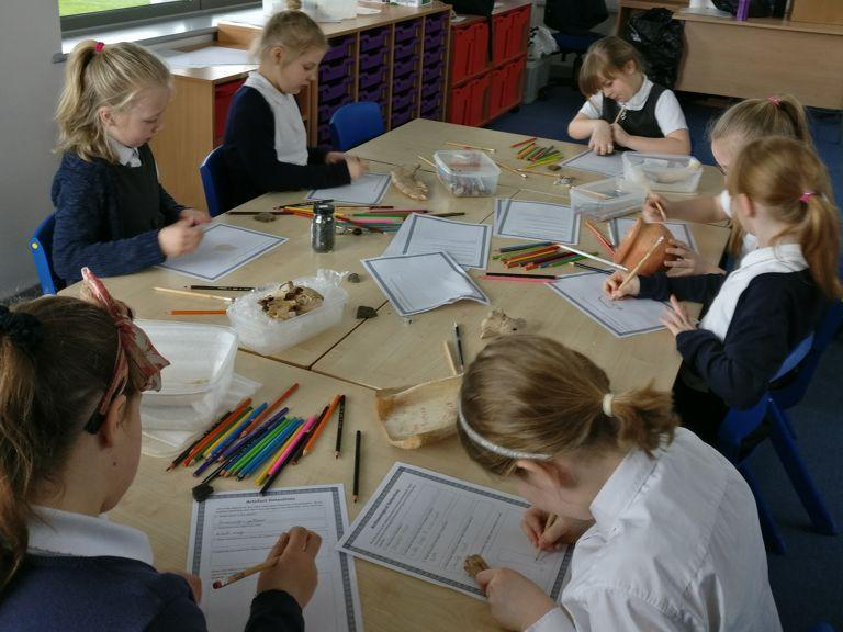 Pupils of Old Sarum Primary School completing worksheets