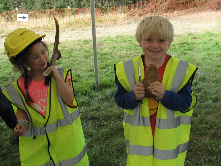 Children engaged in archaeological activities at the Sherford open day