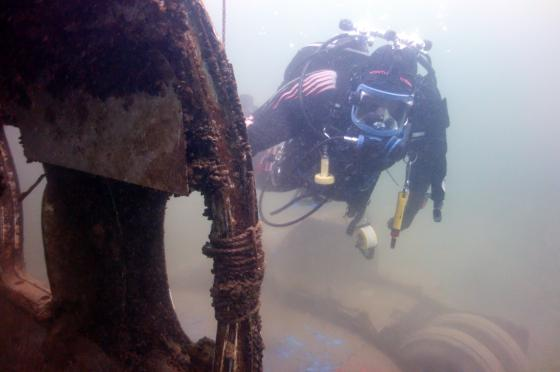 Diver surveying an underwater wreck site